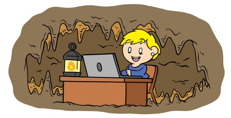 Why You Need A Dedicated Writing Space And How To Find It - A writer sets up their desk in a cave.