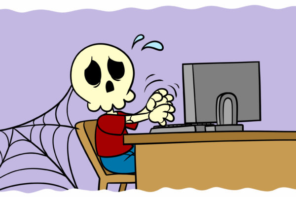 Are You A Binge Writer? Here's How (And Why) To Stop - A skeleton sits at a desk, still typing.